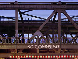 Mike painted graffiti on the side of a bridge. His remark says ''NO COMMENT.''