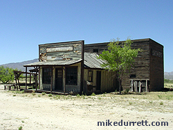 Disheveled business is on the main Mescal street, but set apart from the parallel rows of stores. Photo copyright 2003-2004 Mike Durrett, all rights reserved.