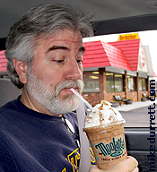 Rare surveillance photo shows Mike inhaling a Moolatte.