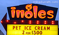 Supermarket street sign says: ''PET ICE CREAM, 2 FOR $500''