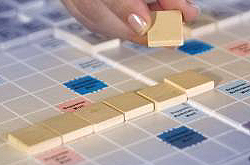 The seven SCRABBLE tiles making up Mike's word in play are blank.