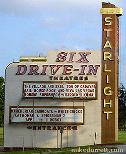 The Starlight Drive-In Theatre marquee on Elvis Presley Mondo Movie Night. Bug spots on vehicle window glass, not the sign. Photo copyright 2004 Mike Durrett, all rights reserved.